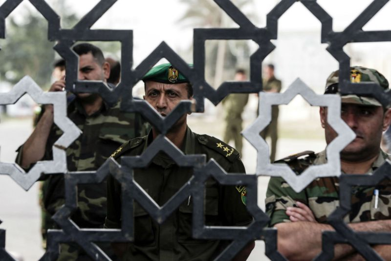 Palestinian security forces loyal to Hamas stand guard outside the Rafah border crossing with Egypt in November 2017. MAHMUD HAMS/AFP/Getty Images