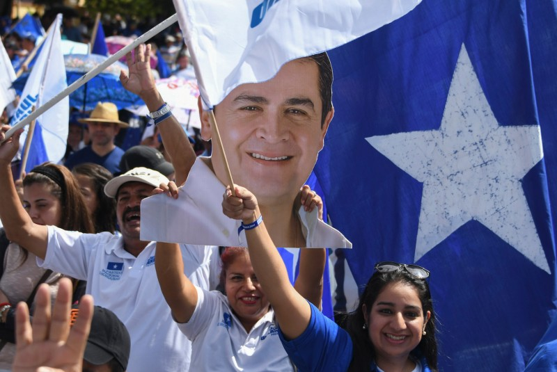 People take part in a rally supporting Honduran President Juan Orlando Hernández in Tegucigalpa on Nov. 5. (Orlando Sierra/AFP/Getty Images)