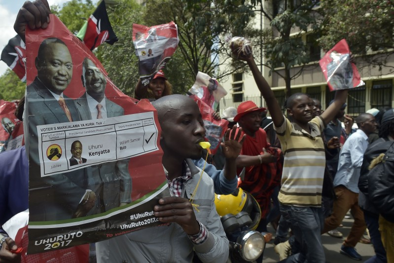 Supporters of President Uhuru Kenyatta celebrate on Nov. 20, in Nairobi after Kenya's Supreme Court dismissed two petitions to overturn the country's Oct. 26 presidential election re-run, validating the poll victory of Kenyatta.(Simon Maina/AFP/Getty Images)