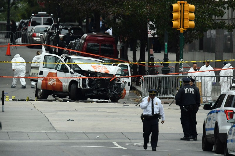 Investigators work around the wreckage of a Home Depot pickup truck that was used in a terror attack on Oct. 31 in New York City. The driver pledged loyalty to the Islamic State. (Jewel Samad/AFP/Getty Images)