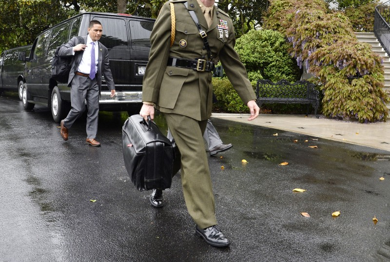 "A military aide carries the ""nuclear football"" on the South Lawn of the White House on April 25 in Washington, DC. (Olivier Douliery-Pool/Getty Images)"