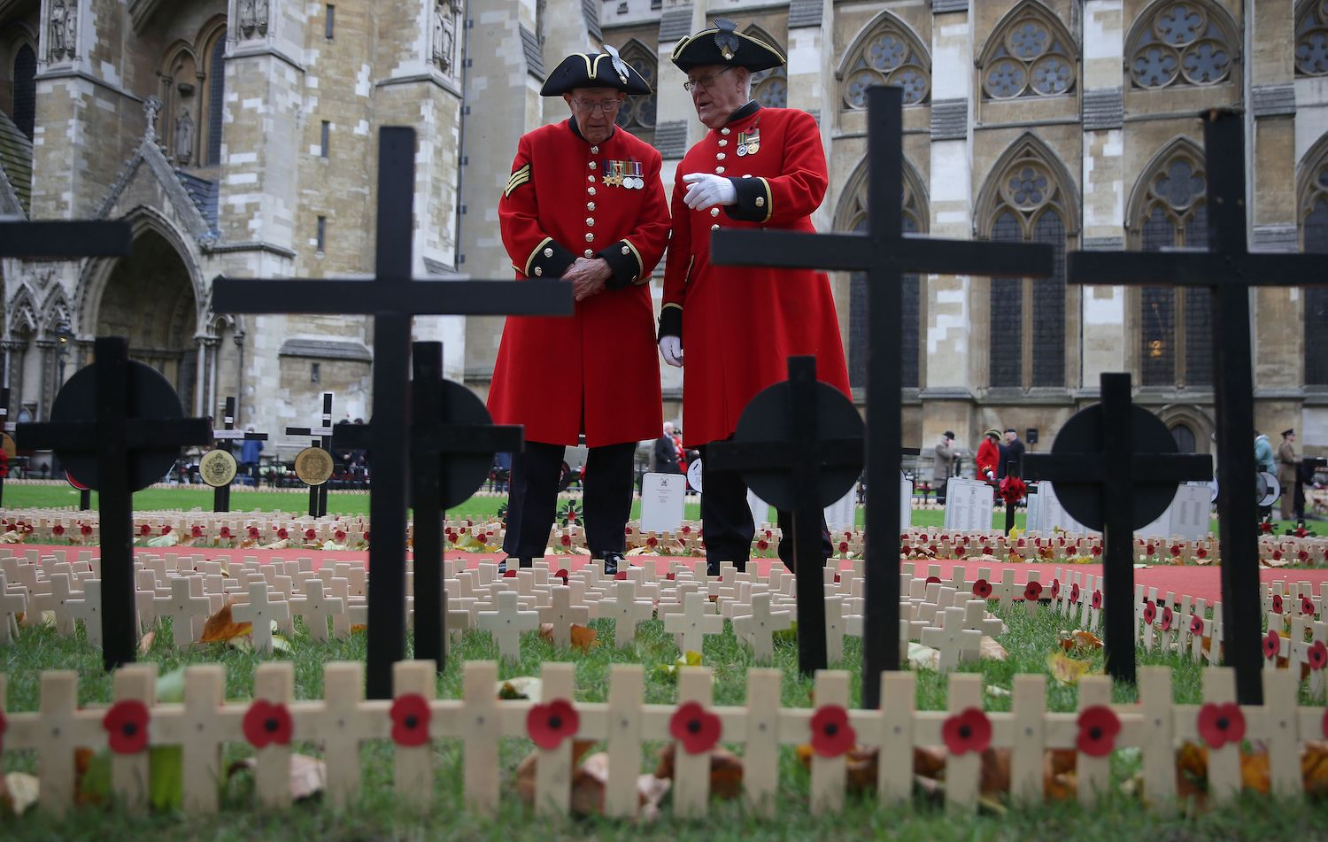 Chelsea pensioners look at Crosses of Remembrance, as they pay their respects at Field of Remembrance at Westminster Abbey in central London on Nov. 9. (Daniel Leal-Olivas/AFP/Getty Images)