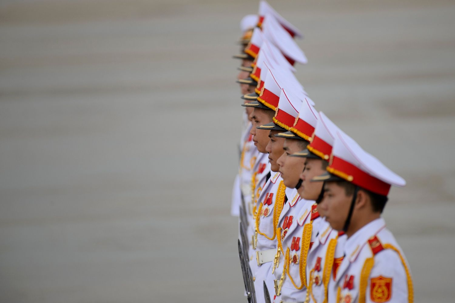 Members of a Vietnamese honor guard stand at attention during the arrivals of leaders at the international airport ahead of the Asia-Pacific Economic Cooperation (APEC) Summit in the central Vietnamese city of Danang on Nov. 9.Ye Aung Thu/AFP/Getty Images