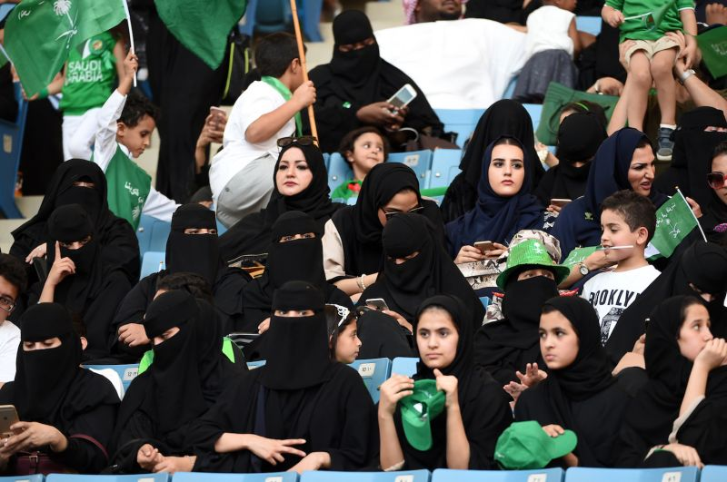 Saudi women sit in a stadium for the first time to attend an event in the capital Riyadh on Sept. 23, commemorating the anniversary of the founding of the kingdom. (Fayez Nureldine/AFP/Getty Images)