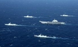 A Chinese navy formation, including the aircraft carrier Liaonin, takes part in military drills in the South China Sea on Jan. 2. (Stringer/AFP/Getty Images)