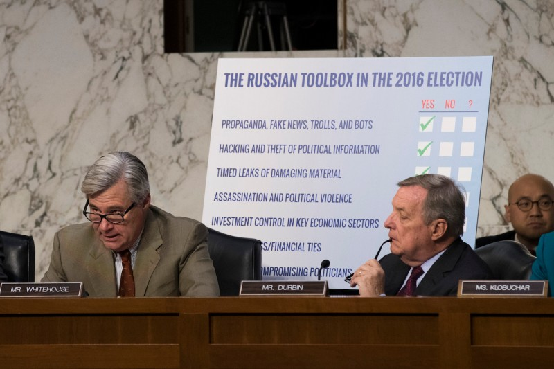 (Left to right) Subcommittee ranking member Sen. Sheldon Whitehouse (D-RI) speaks as Sen. Dick Durbin (D-IL) looks on during a Senate Judiciary Subcommittee on Crime and Terrorism hearing titled 'Extremist Content and Russian Disinformation Online' on Capitol Hill, Oct. 31, in Washington, D.C. (Drew Angerer/Getty Images)