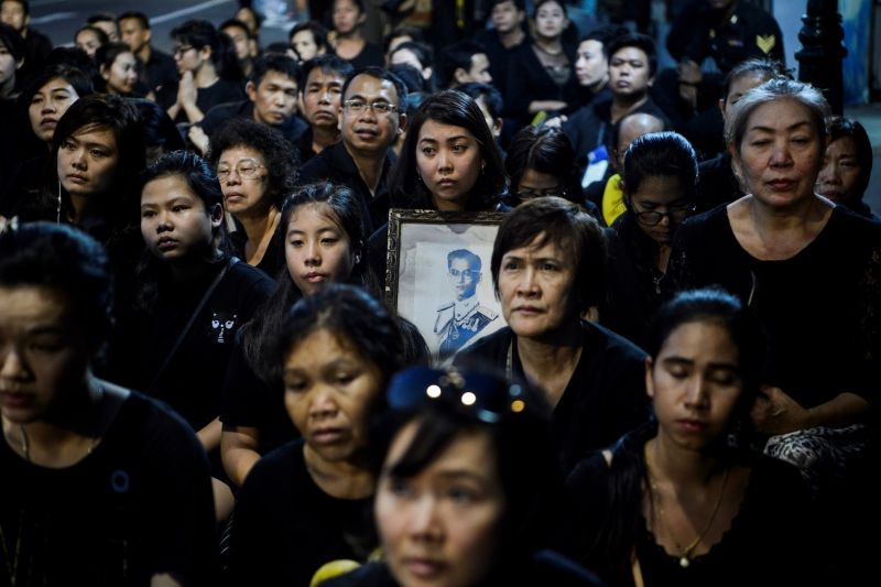Mourners pray for the late Thai King Bhumibol Adulyadej during the procession transferring the relics and his ashes from the Grand Palace to a local temple in Bangkok on Oct. 29. (Ye Aung/AFP/Getty Images)