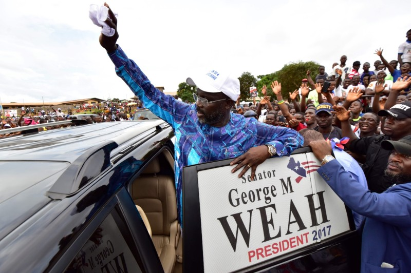 Senator George Weah greets his supporters during a campaign rally in Monrovia on Oct. 8. (Issouf Sanogo/AFP/Getty Images)