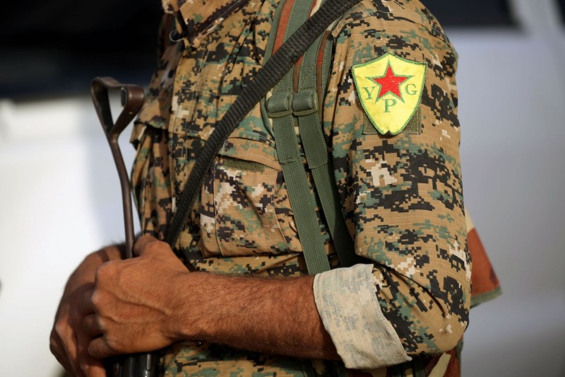 The insignia of the Kurdish People's Protection Units (YPG) on a member's uniform in al-Karamah, Syria on May 10. (Delil Souleiman/AFP/Getty Images)
