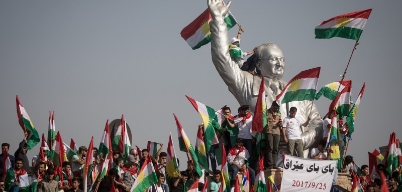 Supporters wave flags as they wait for Masoud Barzani's arrival during a rally in Erbil, Iraq, on Sept. 22, 2017, for the independence referendum later that month. (Chris McGrath/Getty Images)