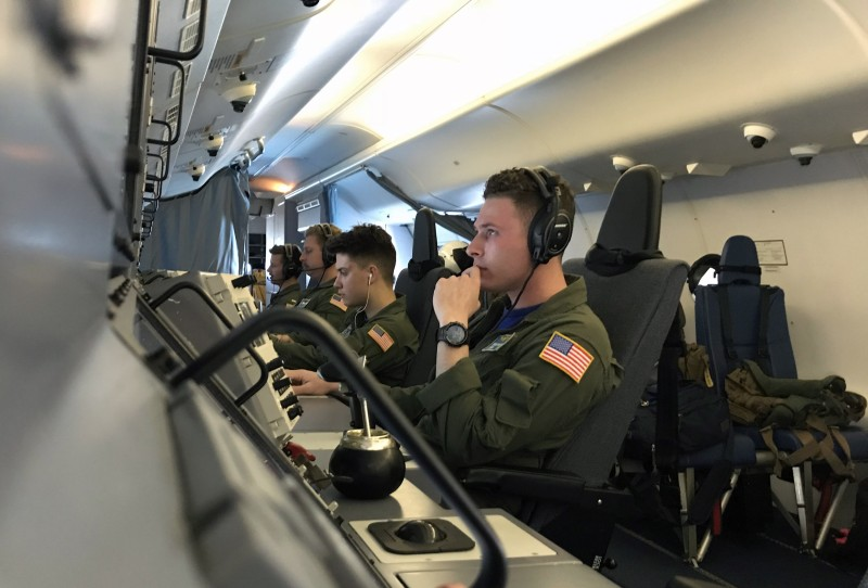 U.S. Navy Patrol and Reconnaissance Wing 11 fly on a P8-A Poseidon aircraft on Nov. 2. (Carlos Reyes/AFP/Getty Images)