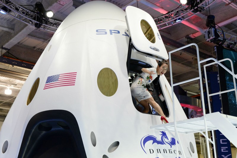 Robin Lee walks out after touring the cabin of the Dragon V2 after SpaceX CEO Elon Musk unveiled the company's new manned spacecraft, The Dragon V2, on May 29, 2014. (Kevork Djansezian/Getty Images)