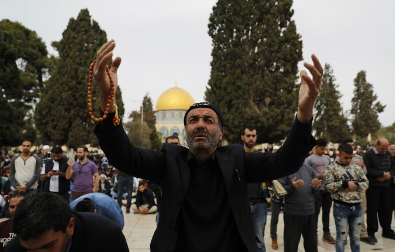 Muslim worshippers perform Friday noon prayer near the Dome of the Rock mosque in Jerusalem's Old City's al-Aqsa mosque compound on Dec. 22, 2017. (Ahmad Gharabli/AFP/Getty Images)