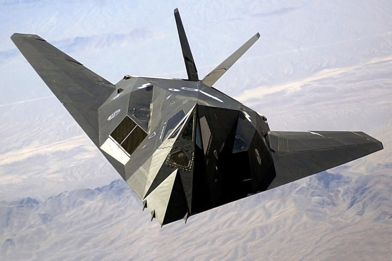 A US Air Force (USAF) F-117A Nighthawk Stealth Fighter aircraft flies over Nellis Air Force Base (AFB), Nevada (NV), during the joint service experimentation process dubbed Millennium Challenge 2002 (MC02). (Staff Sgt. Aaron Allmon II via Wikimedia Commons).