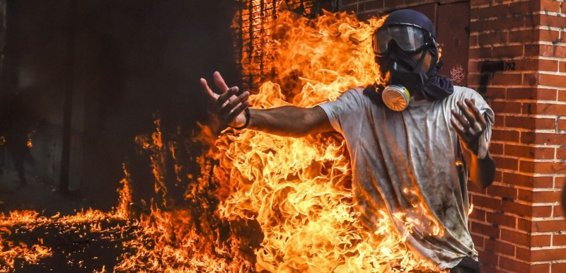 A demonstrator catches fire, after the gas tank of a police motorbike exploded, during clashes in a protest against Venezuelan President Nicolas Maduro, in Caracas on May 3. (Juan Barreto/AFP/Getty Images)