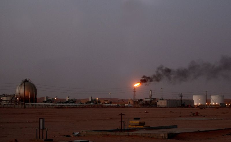A flame from a Saudi Aramco oil installation  burns brightly during sunset in the Saudi desert on June 23, 2008.  (AFP/Marwan Naamani)