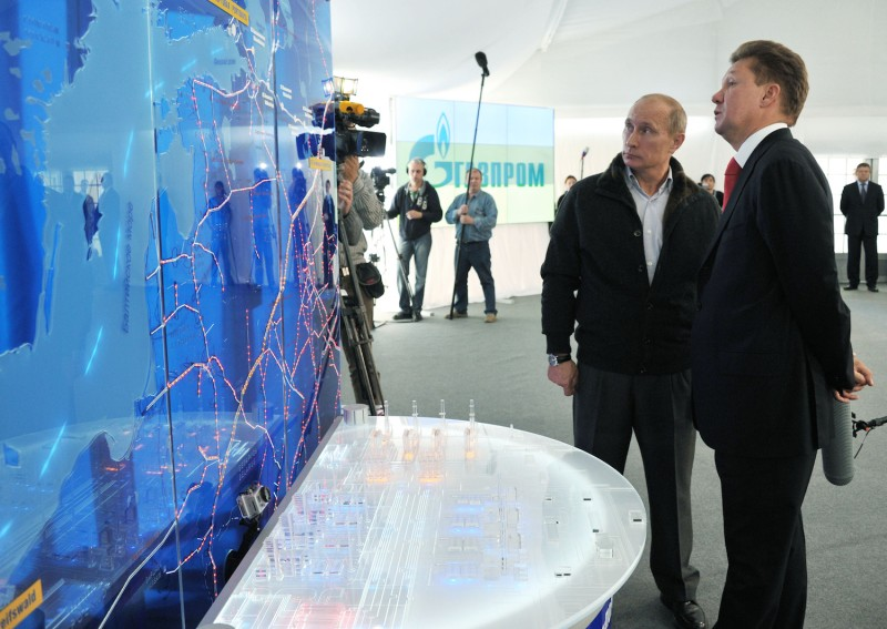 Vladimir Putin and Gazprom CEO Alexei Miller examine a map of the Nord Stream gas project outside Vyborg, Russia on Sept. 6, 2011. (Alexey Nikolsky/AFP/Getty Images)