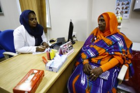 Aida Abdulla speaks to Dr Samrin Farouk Habbani at the Khartoum Breast Care Centet on Oct. 15, 2015.  (Ashraf Shazly/AFP/Getty Images)