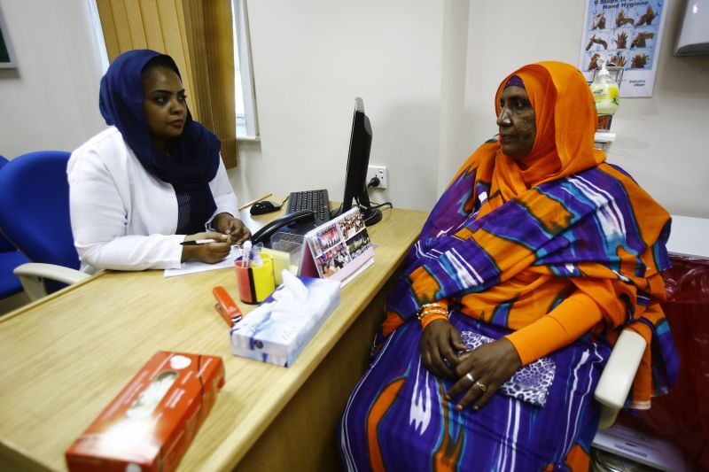 Aida Abdulla speaks to Dr Samrin Farouk Habbani at the Khartoum Breast Care Centet on Oct. 15, 2015.  (Ashraf Shazly/AFP/Getty Images)