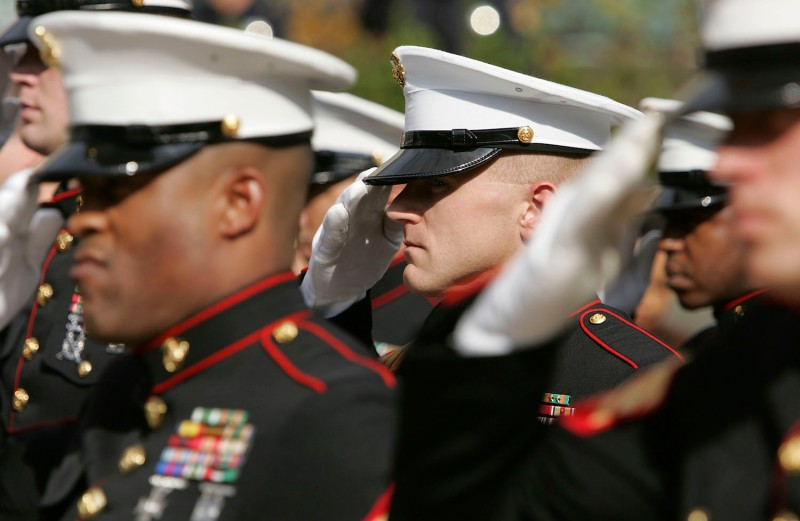 Members of the U.S. Marine Corp honor guard salute during the singing of the National Anthem. (Justin Sullivan/Getty Images)