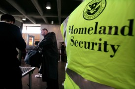 A Department of Homeland Security official at a train station in Jersey City, New Jersey on February 7, 2006. (Spencer Platt/Getty Images)