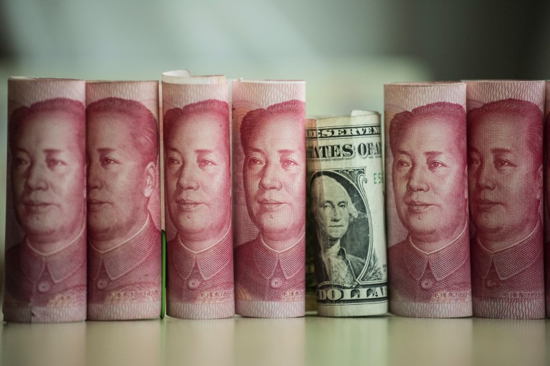 Chinese 100 yuan notes and one U.S. dollar on Jan. 6, 2017. (Fred Dufour/AFP/Getty Images)