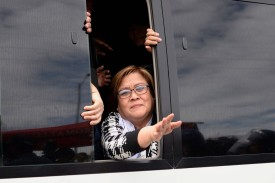 Philippine Senator Leila de Lima waves to supporters after appearing in court outside Manila on Feb. 24. (Noel Celis/AFP/Getty Images)