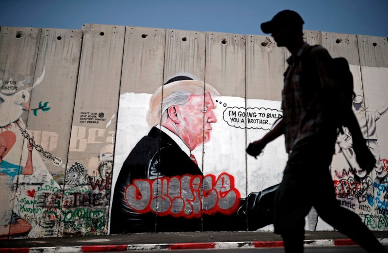 Graffiti depicting U.S. President Donald Trump on the Israeli separation barrier between the West Bank town of Bethlehem and Jerusalem on Aug. 25. (Thomas Coex/AFP/Getty Images)