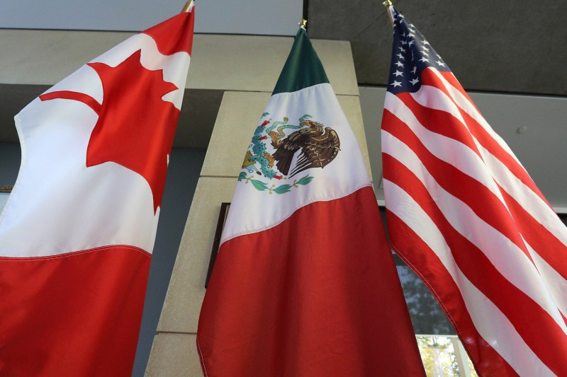 The Mexican, U.S., and Canadian flags in Ottawa, Ontario, on Sept. 24.  (Lars Hagberg/AFP/Getty Images)