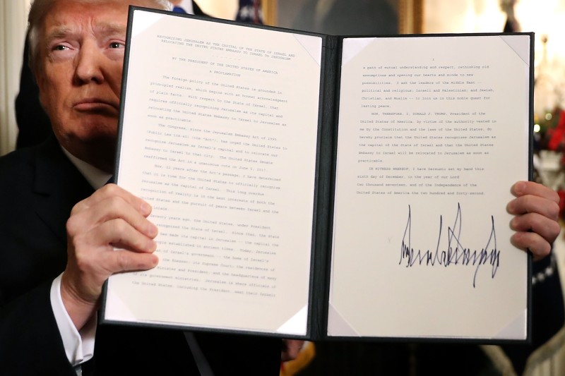U.S. President Donald Trump with a proclaimation that the U.S. government will formally recognize Jerusalem as the capital of Israel on December 6, 2017. (Chip Somodevilla/Getty Images)