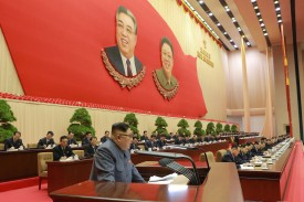 North Korean leader Kim Jong Un address the 5th Congress of the Workers' Party of Korea on Dec. 23. (KCNA/AFP/Getty Images)