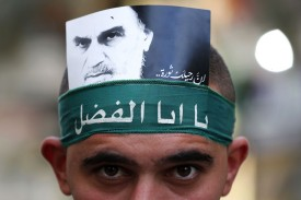 A Hezbollah supporter displays a picture of Iran's late Ayatollah Khomeini, in a southern suburb of Beirut, Lebanon, on Oct. 1. (Anwar Amro/AFP/Getty Images)