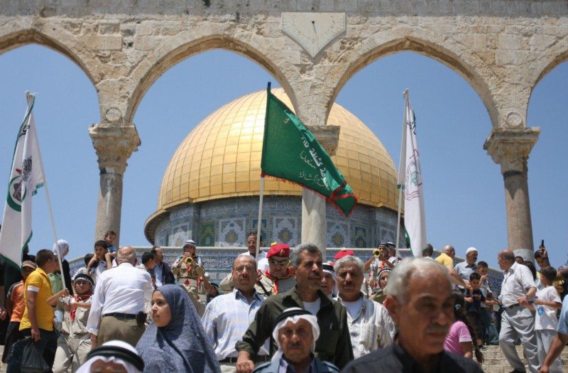 Muslim worshippers walk in front of the Dome of the Rock shrine in Jerusalem on July 30, 2008. (Ahed Izhiman/AFP/Getty Images)