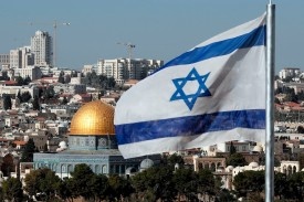 The Israeli flag flies in front of the Dome of the Rock in Jerusalem on Dec. 1, 2017. (Thomas Coex/AFP/Getty Images)
