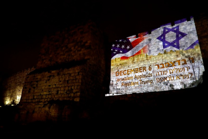 A giant US flag screened alongside Israel's national flag by the Jerusalem municipality on the walls of the old city on Dec. 6. (AFP photo / Ahmad Gharabali)