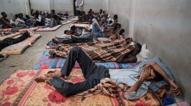Migrants rest at a detention center in the Libyan city of Zawiyah on June 17. (Taha Jawashi/AFP/Getty Images)