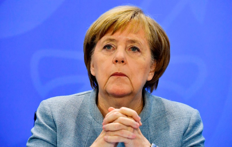 "German Chancellor Angela Merkel speaks during a press conference following a so-called ""Diesel Summit"" with mayors of large German cities in the chancellery in Berlin on Nov. 28, in order to look at ways of improving air quality. (John MacDougall/AFP/Getty Images)"