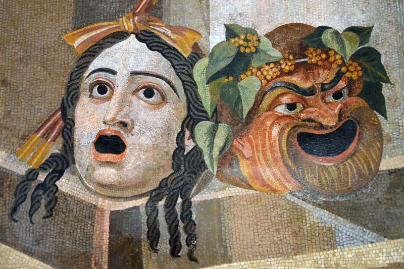 A mosaic depicting theatrical masks of tragedy and comedy. (Palazzo Nuovo, Hall of the Doves via Wikimedia Commons)