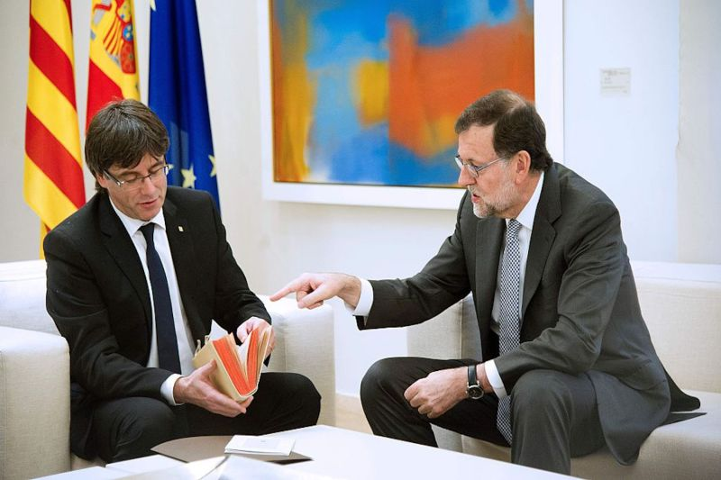 Spanish Prime Minister Mariano Rajoy and Catalan Prime Minister Carles Puigdemont during their meeting at La Moncloa palace in Madrid on April 20, 2016. (Curto de la Torre/AFP/Getty Images)
