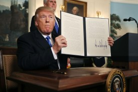 President Donald Trump holds up a proclaimation that the U.S. government will formally recognize Jerusalem as the capital of Israel on Dec. 6, at the White House. (Chip Somodevilla/Getty Images)