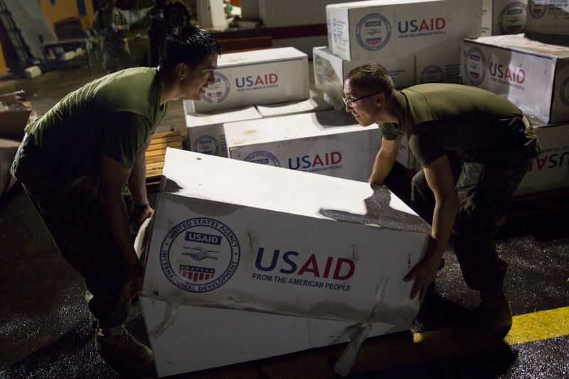 U.S. Marines assigned to Joint Task Force - Leeward Islands stack boxes of tarps from the U.S. Agency for International Development as they prepare supplies for distribution at Douglas-Charles Airport in Melville Hall, Dominica, Sept 29. (Sgt. Melissa Martens/U.S. Marines via Getty Images)