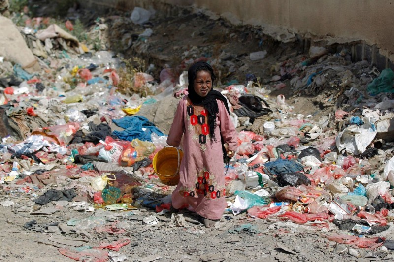 A girl walks among rubbish in a slum in the Yemeni capital Sanaa on Nov. 9, 2016. (Mohammed Huwais/AFP/Getty Images)