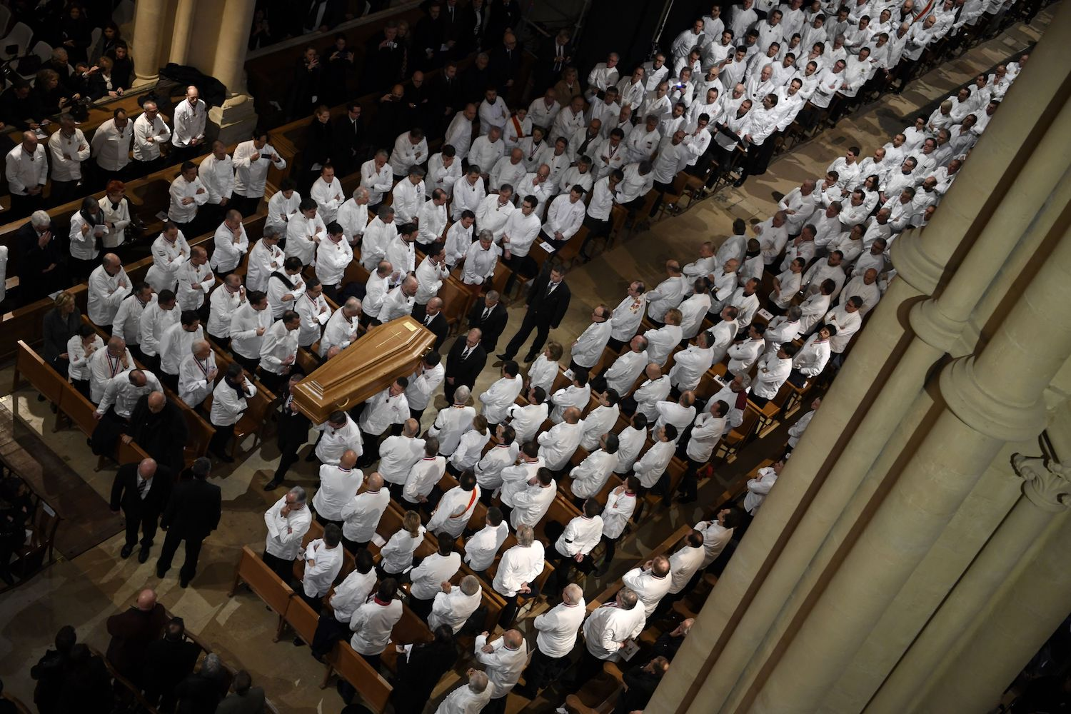 "Chefs carry the coffin of French chef Paul Bocuse  during the funeral ceremony at the Saint-Jean Cathedral in Lyon on Jan. 26. More than 1,500 chefs from around the world along with thousands of fans of French cuisine were expected in Lyon on January 26, 2018 to honour their ""pope"" Paul Bocuse, who died last January 20 aged 91. / AFP PHOTO / POOL / Philippe DESMAZES        (Photo credit should read PHILIPPE DESMAZES/AFP/Getty Images)"