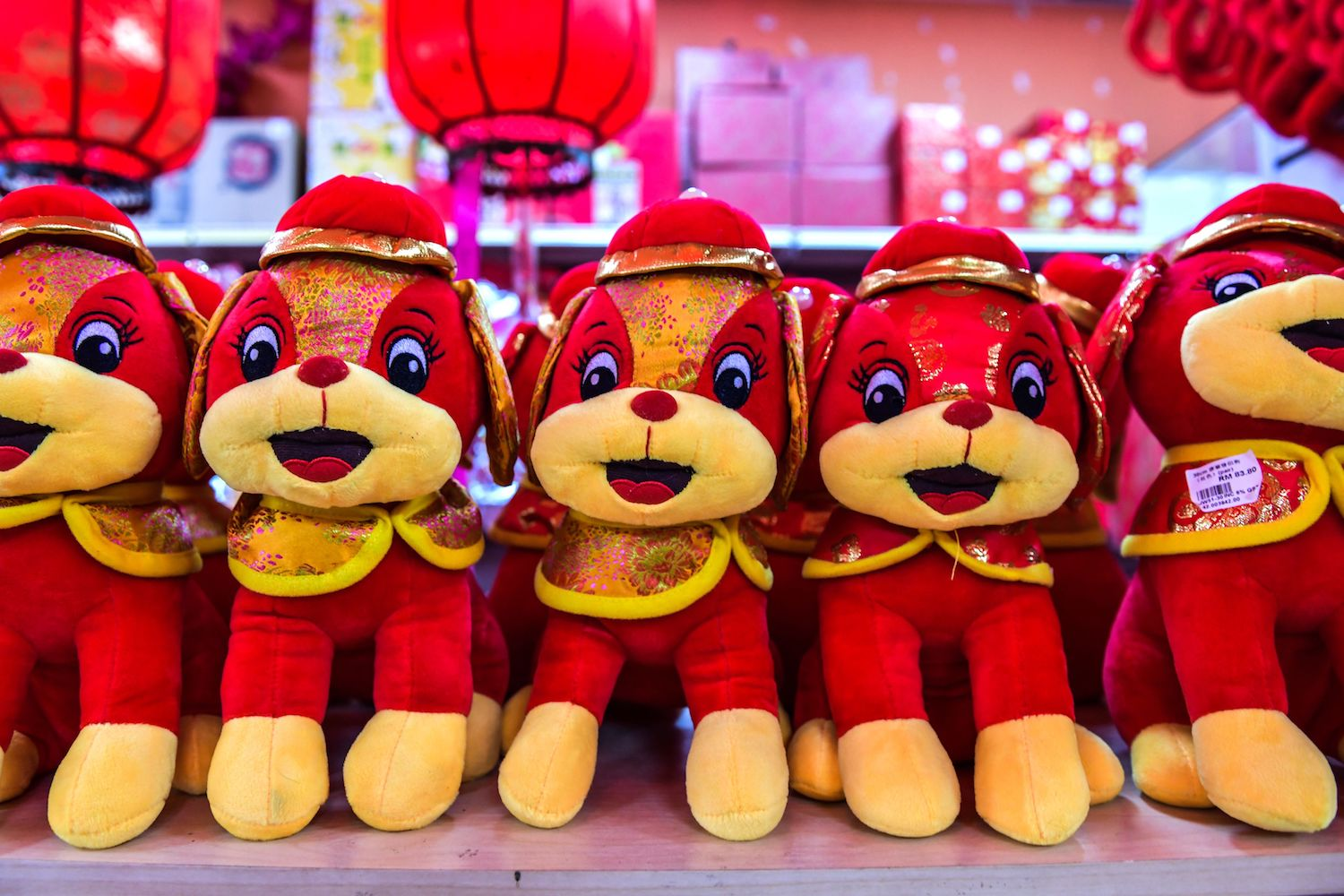 Decorative dog figurines are seen for sale ahead of the Lunar New Year celebrations in Kuala Lumpur's Chinatown on Jan. 26.