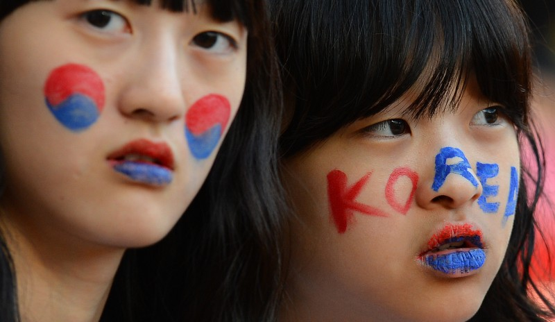 Korean fans at the London 2012 Olympic Games. (Andrew Yates/AFP/GettyImages)