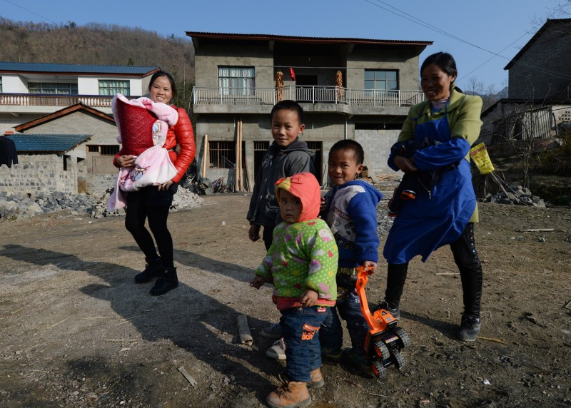 Rural residents near the city of Anshun, China on Feb. 20, 2014. (Mark Ralston/AFP/Getty Images)