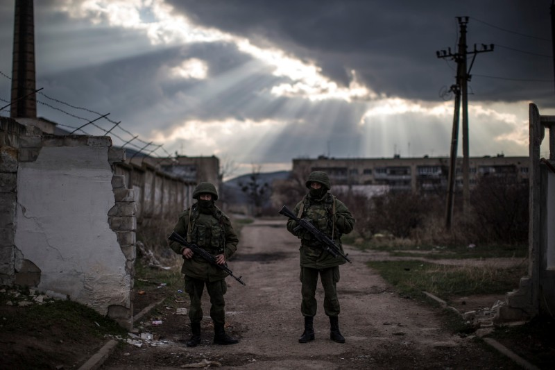 Alleged Russian soldiers stand outside a Ukrainian military base in Simferopol on March 12, 2014. (Dan Kitwood/Getty Images)