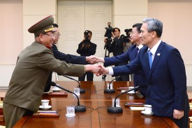 North and South Korean officials during a meeting at the truce village of Panmunjom inside the Demilitarized Zone on August 22, 2015. (South Korean Unification Ministry via Getty Images)