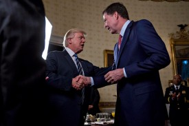 U.S. President Donald Trump shakes hands with then-FBI Director James Comey at the White House on Jan. 22, 2017. (Andrew Harrer-Pool/Getty Images)