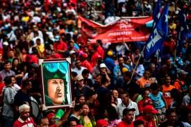 A pro-government activist holds a portrait of late Venezuelan President Hugo Chávez, during a demonstration on Aug. 14, 2017. (Ronaldo Schemidt/AFP/Getty Images)